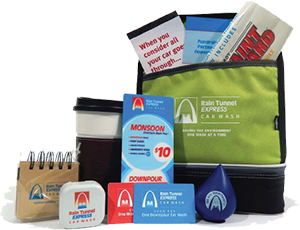 Multiple branded promotional gifts fill a lunch bag